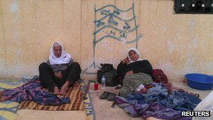 Displaced Syrians lying on makeshift beds