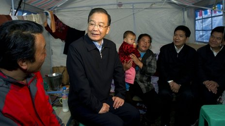 Wen Jiabao talks to villagers after a deadly landslide in Yunnan, 2012