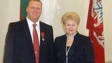 Jon Rudd (left) and Lithuanian President Dalia Grybauskaite