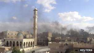 Smoke rises over Maaret al-Numan in Idlib, Syria (8 Oct 2012)
