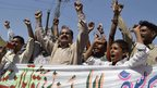 Pakistani activists shout slogans during a protest against an assassination attempt on Malala Yousafzai, in Multan on October 10