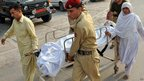 Pakistani soldiers carry injured Malala Yousafzai at an army hospital in Peshawar in this handout photograph released by Pakistan's Inter Services Public Relations office