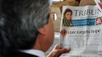 A Pakistani train traveller reads a local newspaper featuring news of Malala Yousafzai during a flight over Pakistan on 10 October, 2012