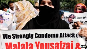 Peace activists carry photos of gunshot victim Malala Yousafzai during a protest rally against her assassination attempt, in Peshawar 10 October, 2012.