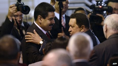 Nicolas Maduro (left) and Hugo Chavez