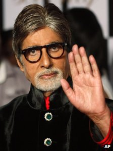Bollywood star Amitabh Bachchan gestures as he arrives for a party on the eve of his 70th birthday in Mumbai, India, Wednesday, Oct. 10, 2012.