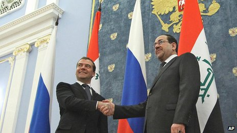 Russian Prime Minister Dmitry Medvedev shake hands with Iraq&#039;s Prime Minister Nouri Al-Maliki (R) outside Moscow on 9 October 2012