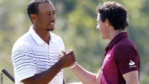 Tiger Woods (left) with Rory McIlroy