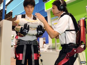 Students of the Science University of Tokyo demonstrate a robotic 'Muscle Suit' at Asia's largest electronics trade show CEATEC, 02 Oct 2012