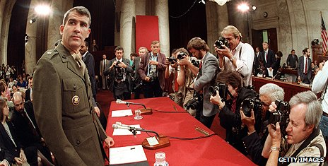 Oliver North prepares to give evidence