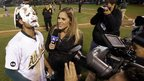 Baseball player Coco Crisp talks to TV crew after a teammate has hit him in the face with a foam pie