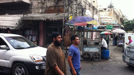 Men walking on Omar Al Muhktar street