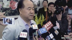 Chinese writer Mo Yan (L) talks to the press in his hometown Gaomi in China's Shandong province after he was notified with his Nobel prize for literature victory, 11 Oct 2012