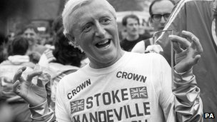 Sir Jimmy Savile after running a marathon in aid of Stoke Mandeville Hospital