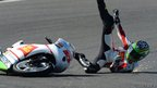 Simone Corsi of Italy falls of his motorbike