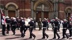 Band members were filmed playing loyalist tunes while marching in circles outside the Catholic church