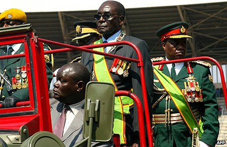 Robert Mugabe inspects the guard of honour during Defence Forces Day celebrations