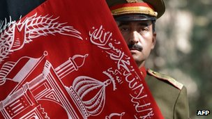 File photo: Afghan soldier holding country's flag