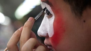 Chinese actor applying face paint
