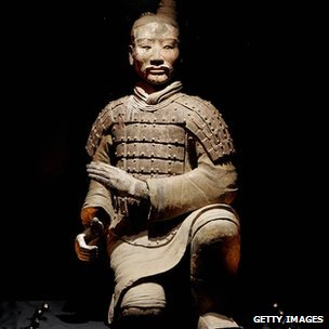 The figure of a kneeling archer is displayed at an exhibition entitled 'The First Emperor: China's Terracotta Army' at the British Museum