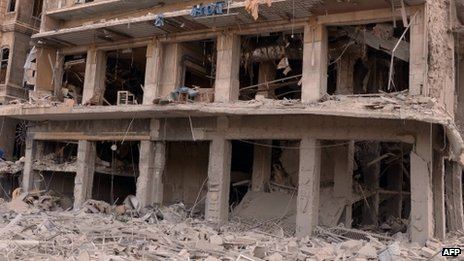 Syrian's state news agency (SANA) issued this photo of this building torn apart by a bombing in a government-controlled district of Syria's commercial capital, Aleppo
