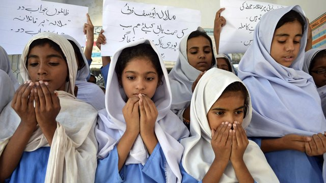 Pakistani school girls pray for the recovery of gunshot victim, Malala Yousafzai