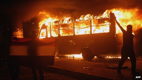 Bus alight in Cairo protest. 12 Oct 2012