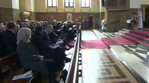 Mourners at the memorial service for Lord Morris