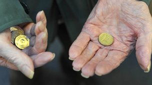Old man with coins