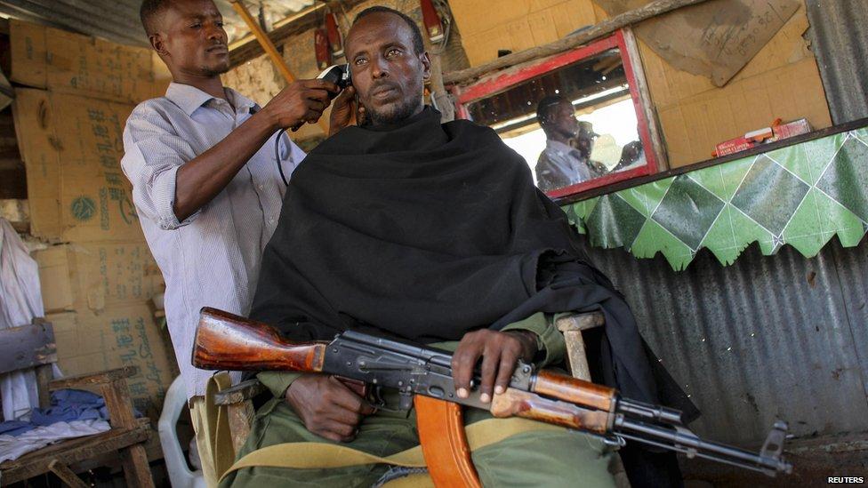 [Image: _63463846_03_somalia_barber_reuters.jpg]