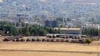 Turkish tanks take position near the border with Syria at Suruc in Sanliurfa (12 October 2012).