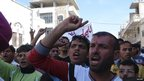 Demonstrators shout slogans during a protest against Syrian President Bashar al-Assad, after Friday prayers in Binsh near Idlib (12 October 2012) Image provided to Reuters by Shaam News Network.