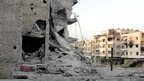 Buildings damaged by what activists said was shelling by forces loyal to Syria's President Bashar al-Assad are seen in Homs October 11, 2012. (11 October 2012). Image provided to Reuters by Shaam News Network.