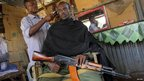 A Somali militiaman in a barber's shop in Kismayo - Sunday 7 October 2012