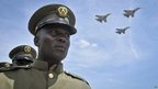 Ugandan soldiers parading as jets fly overhead - Tuesday 9 October 2012
