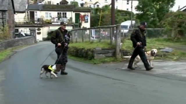 Two police search dogs and their handlers