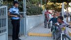 Children play outside the police station in Akcakale