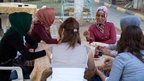 Residents chat over tea at a local cafe