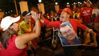 Supporters of Venezuela&#039;s President Hugo Chavez cheer after polling stations closed and before any results were made available in Caracas, Venezuela.