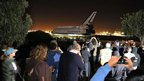 Spectators watch Space Shuttle Endeavour leave Los Angeles International Airport (LAX) (12 Oct 2012)