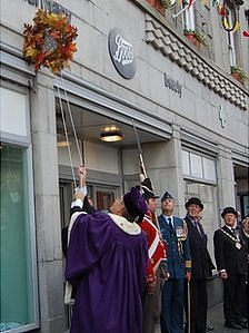 Wreath raised under the Sir Isaac Brock plaque on Boots in St Peter Port, Guernsey