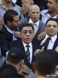The chief prosecutor of Egypt, Abdel Maguid Mahmoud, surrounded by supporters, 13 October