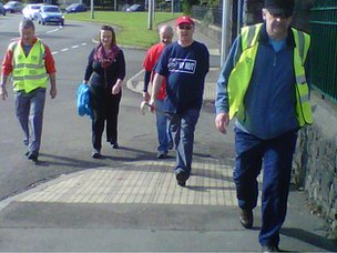 Cerith Griffiths (red shirt), Steffan ap Dafydd (red cap) and Richard Evans (right) embark on their protest walk