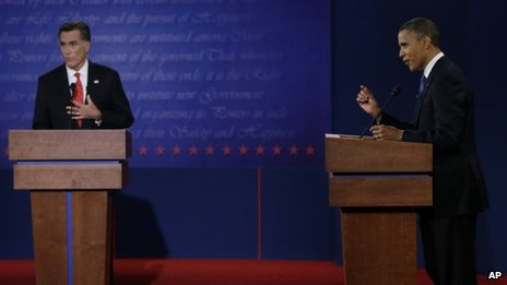 Republican presidential nominee Mitt Romney and President Barack Obama speak during the first presidential debate at the University of Denver Oct 3 2012