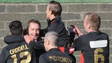 Timmy Adamson is embraced by team-mates after putting Crusaders ahead against Cliftonville