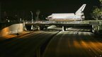 Space shuttle Endeavour makes it over a closed freeway in Inglewood
