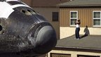 A man photographs Endeavour in Los Angeles, 13 October