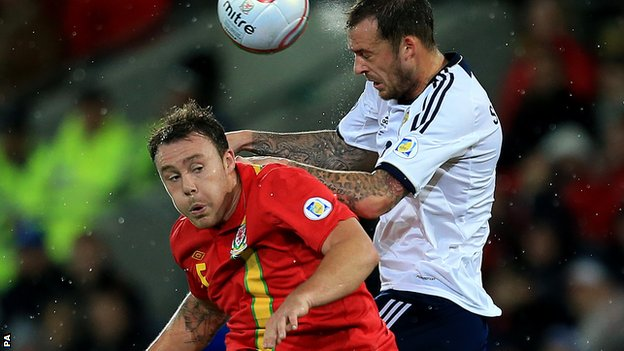 Darcy Blake in action against Scotland&#039;s Steven Fletcher