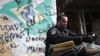 A policeman sorts drugs found at the Jacarezinho slum during a peacekeeping operation in Rio de Janeiro October 14, 2012.