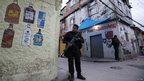 Policemen patrol the Manguinhos slum during an operation to install the Peacekeeping Unit (UPP) riot police in Rio de Janeiro October 14, 2012